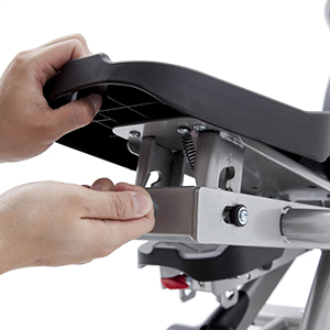 View from back of Spirit Fitness XE295 Elliptical Trainer pedal showing pedal incline adjustment.
