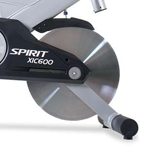 Cropped view from right side of the Spirit Fitness XIC600 Indoor Bike trainer showing grey frame and 48.5 pound stainless steel flywheel.