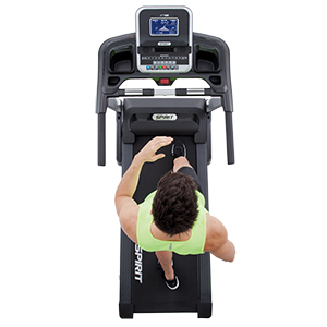 Spirit Fitness XT185 Treadmill overhead view showing a man running on treadmill wearing yellow-green tank top and black shorts.S
