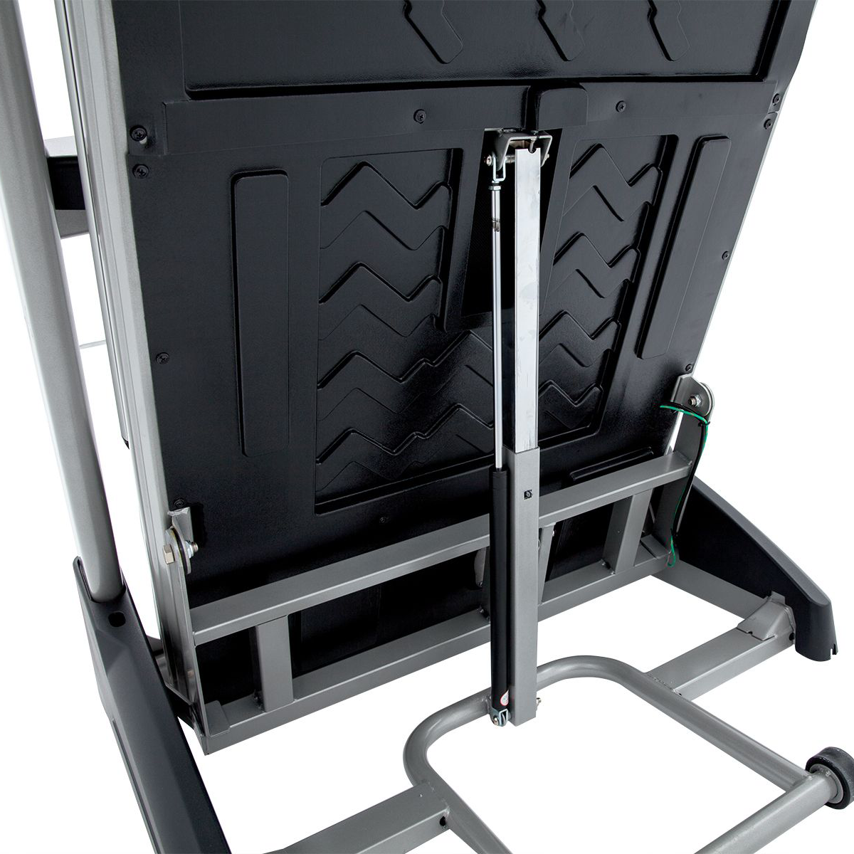 View from under the running deck of Spirit Fitness XT385 treadmill in folded position