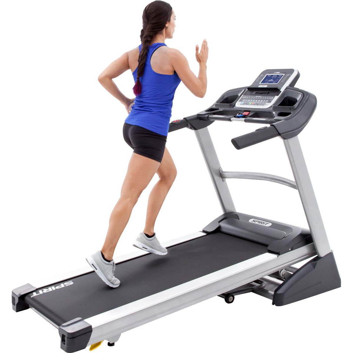 Side view of the Spirit Fitness XT385 treadmill in inclined position with a female model exercising wearing a blue tank top and black shorts