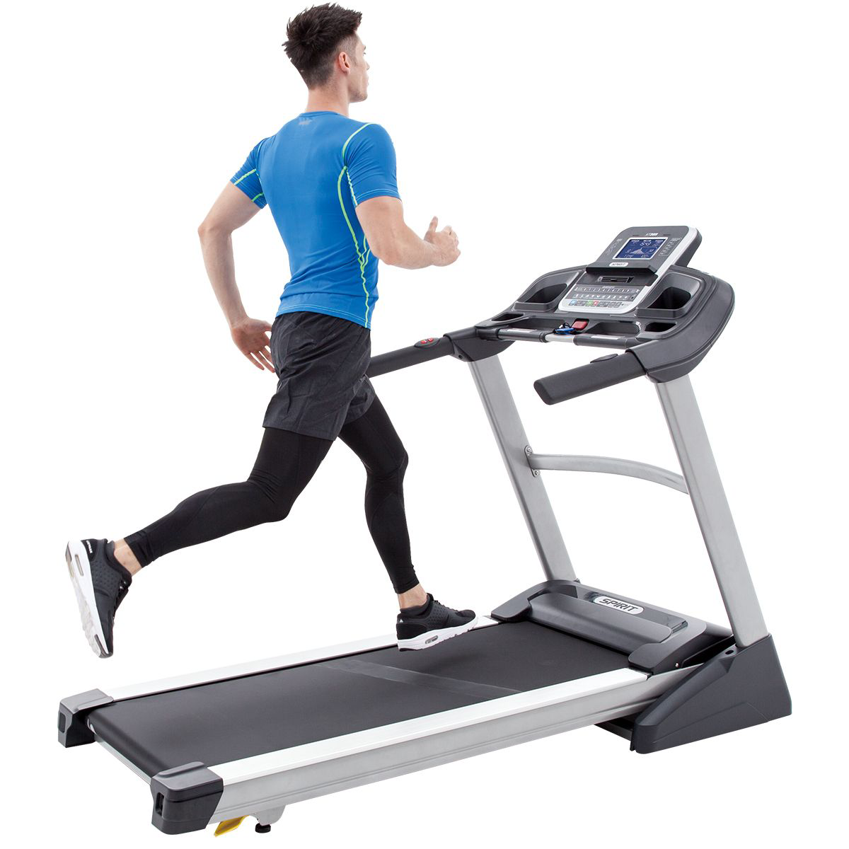Side view of the Spirit Fitness XT385 treadmill in inclined position with a male model exercising wearing a telemetric chest strap, no top, and black shorts