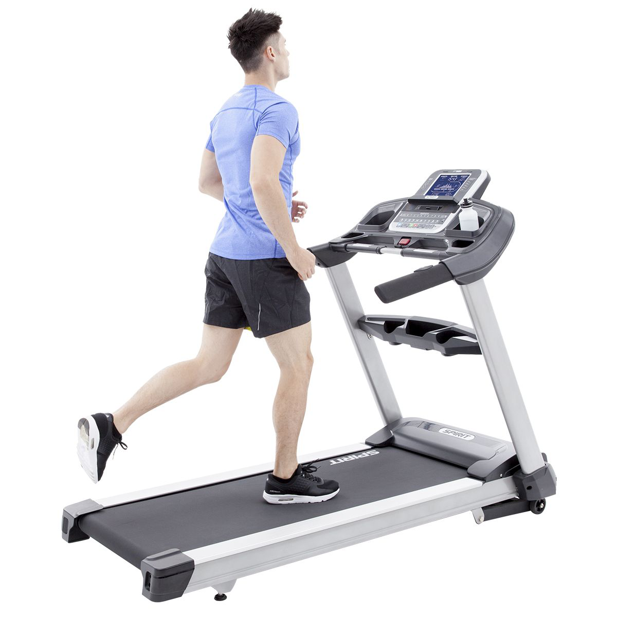 Spirit Fitness XT685 treadmill with male model wearing a blue t-shirt and black shorts