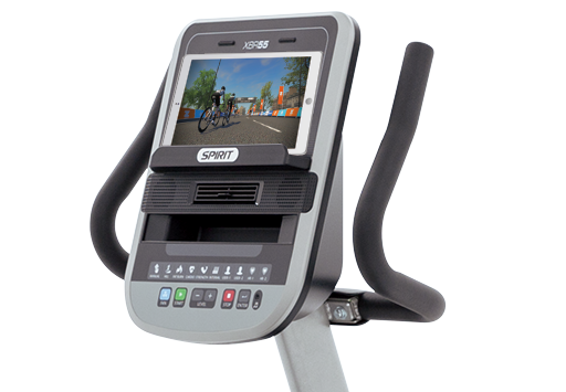 Spirit Fitness XBR55 console with user tablet showing Zwift.